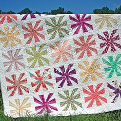 Cartwheels Quilt Pattern - Love this bright and colorful quilt! http://freshlypieced.blogspot.com