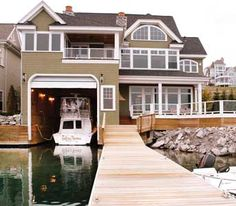 house and boat house together on water. one day...