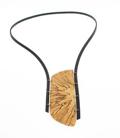Spalted beech, leather handmade unique necklace Wood: spalted beech, surface of the wood is sanded, polished and protected with natural oil -length: 2 3/16, 5,5 cm - width: 1 5/16, 3,3 cm Leather: black Ring: brass The necklace has inner circumference of 29 15/16, 76 cm