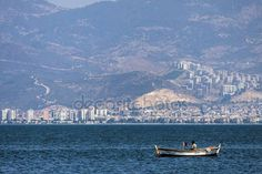 Lonely turkish fisherman on the sea of Izmir (Turkey)