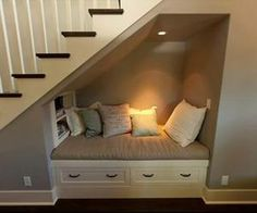 What to do with the unused nook under the stairs - removes the need for a seat/bench in the hallway itself, so you still have somewhere to sit and put shoes on. Plus storage underneath!
