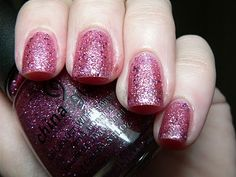 China Glaze - Pom Pom is a light Pink Jelly base packed full of Pink, Silver and larger light Purple glitters