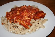 Lazy Chicken Crock Pot Recipe:  frozen chicken pieces and marinara sauce.  dump in Crock Pot and cook on low for 8 hrs or high for 4. Shred chicken with fork; serve over hot pasta.
