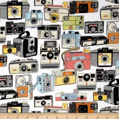 Riley Blake Geekly Chic Cameras White from @fabricdotcom  Designed by Amy Adams for Riley Blake, this cotton print is perfect for quilting, apparel and home decor accents.  Colors include white, black, grey, coral, yellow, orange and blue.