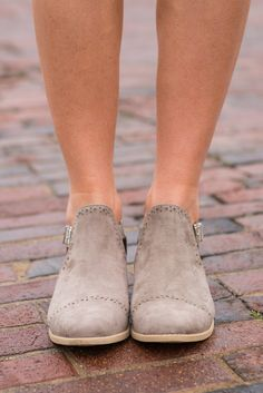 """""""Ahead Of The Game Booties, Taupe""""    With the beautiful booties on your feet, you will totally be ahead of the fashion game! Those cut outs are too chic and that color.... well to say it's amazing is an understatement!"""