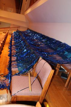 Blue metallic curtains will add an ocean look to your surf! These curtains will be available to purchase through Cokesbury! Mount them over doorways or on walls to create that ocean look. (Here is a way one church set out their curtains before they were mounted!) cokesburyvbs.com