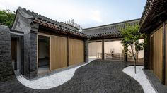 Beijing practice Arch Studio has renovated a traditional courtyard house in the city, adding a paved surface that flows from the floor of the outdoor space