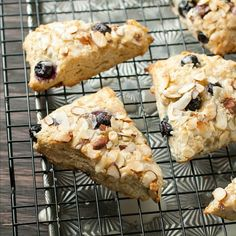 Fluffy Bakery-style Almond Blueberry Scones with a sweet honey-lemon glaze. Perfect for dunking in your coffee or tea!