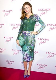 The supermodel looked radiant in a floral cardigan, pencil skirt and handbag, all by Escada, with purple Dior pumps.