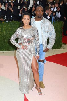 The arrival of Kim Kardashian and Kanye West is always highly-anticipated, and the power couple did not disappoint at this year's Met Gala! Kim rocked a futuristic silver Balmain gown and Kanye donned an embroidered jacket with ripped jeans. The real show-stealer, however, was Kanye's blue contact lenses!