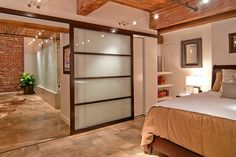 The master bedroom and bathroom had been one large open space. During the two-month renovation, Mr. Bradley added a wall between the two rooms. The master bedroom has a sliding glass door.