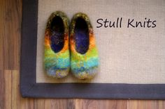 Hey, I found this really awesome Etsy listing at http://www.etsy.com/listing/89950999/wool-felted-stull-slippers-rainbow