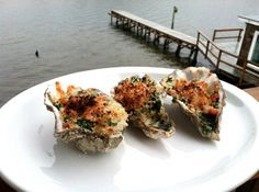 RECIPE: GRILLED OYSTERS ROCKEFELLER WITH BACON - Recently on a vacation to the Oregon Coast, I was inspired to make Oysters Rockefeller with the fresh oysters purchased straight out of the Yaquina Bay in Newport, Oregon.  we grilled the oysters whole in their shells first, popped them open with a shucking blade, dressed them with spinach, tomatoes, garlic, butter, bacon, and cheese, then broiled them in the oven.  The result was truly divine, perfect oysters.