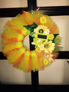 Tulle summer wreath Added sunflowers and other small flowers, greenery, sign, butterflies, propeller, bird.  More at https://www.facebook.com/Moje-vence-995508700482994/