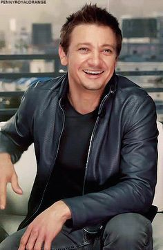 Jeremy Smiling and Wearing Black T-Shirt, Black Leather Jacket and Black Jeans