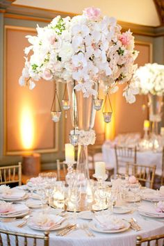 This is so elegant! #Centerpieces #Wedding I like the idea of a higher centerpiece so you don't have to crane your neck to see people on the table.