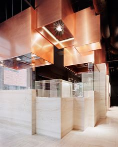 Copper cuboids suspended from Berlin restaurant ceiling.