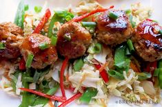 Spicy and sweet meatballs with Tabasco Asian sauce on slaw stir fry.