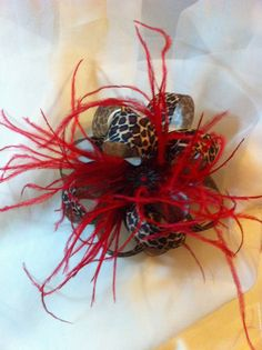 Leopard bow with red feathers