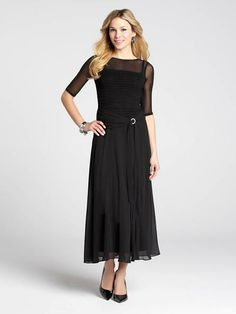 Loaded with details, this chic dress is sure to look great at any evening event. An alluring sheer yoke and pleated bodice combine with a sash waist and chiffon skirt for an effortless, elegant evening look. Side zip closure. Imported. Available in Jet Bl