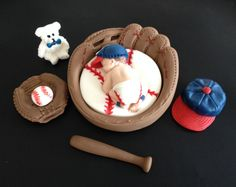 Fondant baby boy baseball inside a 3D glove cake topper in Atlanta Braves colors and logo, baby shower, birthday