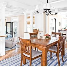 bungalow dining room open to kitchen and living room ( LOVE THIS DINING SET!)