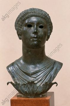 BUST OF A WOMAN / GALLO-ROMAN. Gallo-Roman, 1st century AD.  Bust of a woman.  Bronze. Found: Alesia (Dép. Côte-d'Or, Burgundy, France).