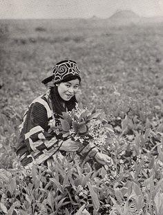 Ainu Woman Gathering Flowers, Hokkaido, Japan