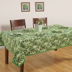 Buy designer spring nature table covershaving attractive leaf patterns in anshade of green in India at best price from saavra.com & decorate your dining table in cheerful spring nature.
