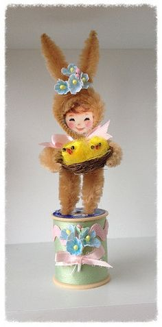 Easter Decoration  A cute chenille bunny ornament was made using a vintage image and brown chenille stems.. Bunny girl is standing on a decorated vintage spool. She is holding a nest of chicks in her arms.    7 inches tall  Easter Ornament