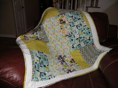 42x44 Toddler Quilt.  Dog themed made from Fat Quarters and scrap fabric binding.  Quilted using stitch in the ditch method.