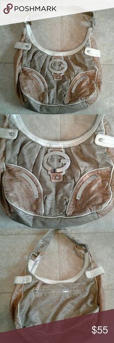 Guess purse OBO This is a all guess leather purse it is a tote it has on the back of a purse it has one zippered pocket and then on the front it has no zippers but it has the big gas symbol and then on the inside there is a lot of smaller pockets and then there also is another zipper pocket it is a very nice purse it is in excellent condition Bags Shoulder Bags