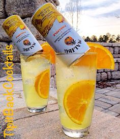 Malibu's most wanted 1 oz Coconut Rum 1/2 orange fresh squeezed 1 can of Malibu Pineapple mixed drink