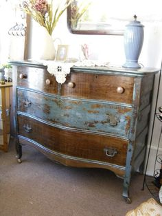 This antique bow front oak dresser has blue chippy paint distressed with shabby chic charm. This versatile dresser would work well in a