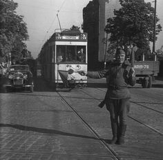 Elderly Soviet soldier directing traffic in Berlin