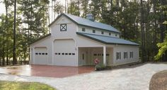 This garage was built for Phil & Judy of Eatonton, GA  Special Features:    Morton's Hi-Rib Steel  Cupola  Loft Door  Windows w/ Shutters  Fiberst...