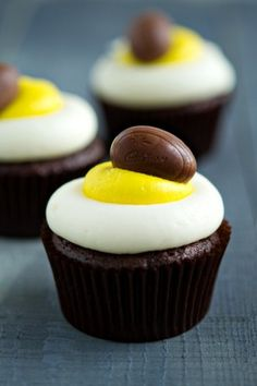 Cadbury creme egg cupcakes. No real recipe - but make your favourite chocolate cupcake and add a frozen mini mini egg in the batter. White and yellow butter cream for the frosting, piped with a round nozzle!