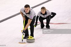 Alexander Eremin (front) and Anastasia Moskaleva of Team Moskaleva (Dmitrov, Russia) in a match against Team Perret (Glarus, Switzerland) at International Mixed Doubles Sochi 2017, an event of the 2017-2018 World Mixed Doubles Curling Tour, at the Ice Cube Curling Center. Valery Sharifulin/TASS