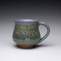 handmade ceramic mug, pottery cup, teacup with green ash glaze and orange shino. $25.00, via Etsy. Ray Morales.