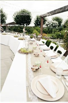 white table cloth with table runner. Looks like you could use cheap fabric and add lace or ribbon trim for cost effective reception decor