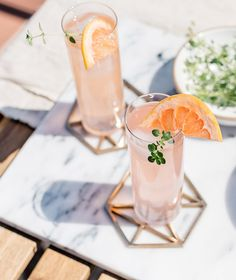 gold coasters and pink cocktail with gin, elderflower, grapefruit, and thyme. / sfgirlbybay