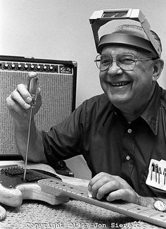 I love this photo of Leo Fender. In a previous life I was a luthier. Leo is a god to us. The simple jigs he came up with to facilitate small batch production. Working man's genius. Hammer frets in? No. . . let's push them in sideways. Yes, it's true.
