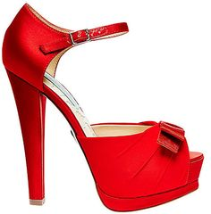 http://www.bellissimabridalshoes.com/trends/platform-wedding-shoes/red-betsey-johnson-pouf-evening-shoes   TheBetsey Johnson Pouf Evening Shoes area show stopping style in red satin. The platform design offers comfort and support as well as a fu