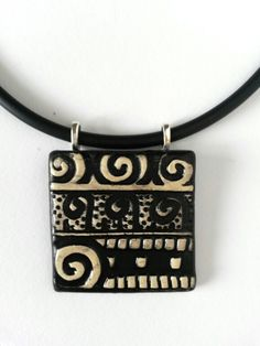 Ceramic pendant by Christine Gittins - christinegittins@aol.com