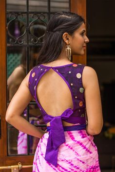 Ready to shop blouses | House Of Blouse.       Chic back style alert! Bringing you cool pre-designed styles in blouses to suit every fancy. A sassy purple blouse with cool polka dot threadwork and a bottom tie back for added sass.   Pair with any saree having purple detailing or pick any of the polka dot colors of orange, cream, peach or pale green…your imagination is the limit!
