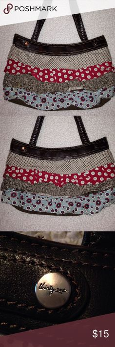 Thirty one Skirt Purse This bag is NWOT and soooo cuteThe outside lining is interchangeable. I don't have anymore skirts but you can purse them on eBay. The base purse is brown. thirty one Bags Shoulder Bags