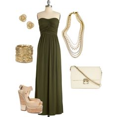 Green maxi dress with gold accessories.