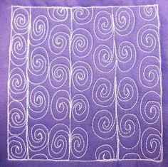 Spiral Vine - For beginners, this is a really simple design that stitches up very easily. So long as you keep the spiral shape in your mind, you'll be good to go. Learn this design at http://freemotionquilting.blogspot.com/2010/05/day-172-spiral-vine.html