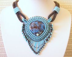 Bead embroidery and weaving by Lithuanian artist Lutita. #beaded #jewellery #jewelry #inspiration