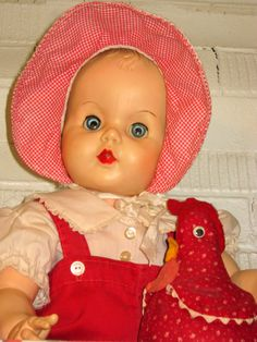 old doll in red.